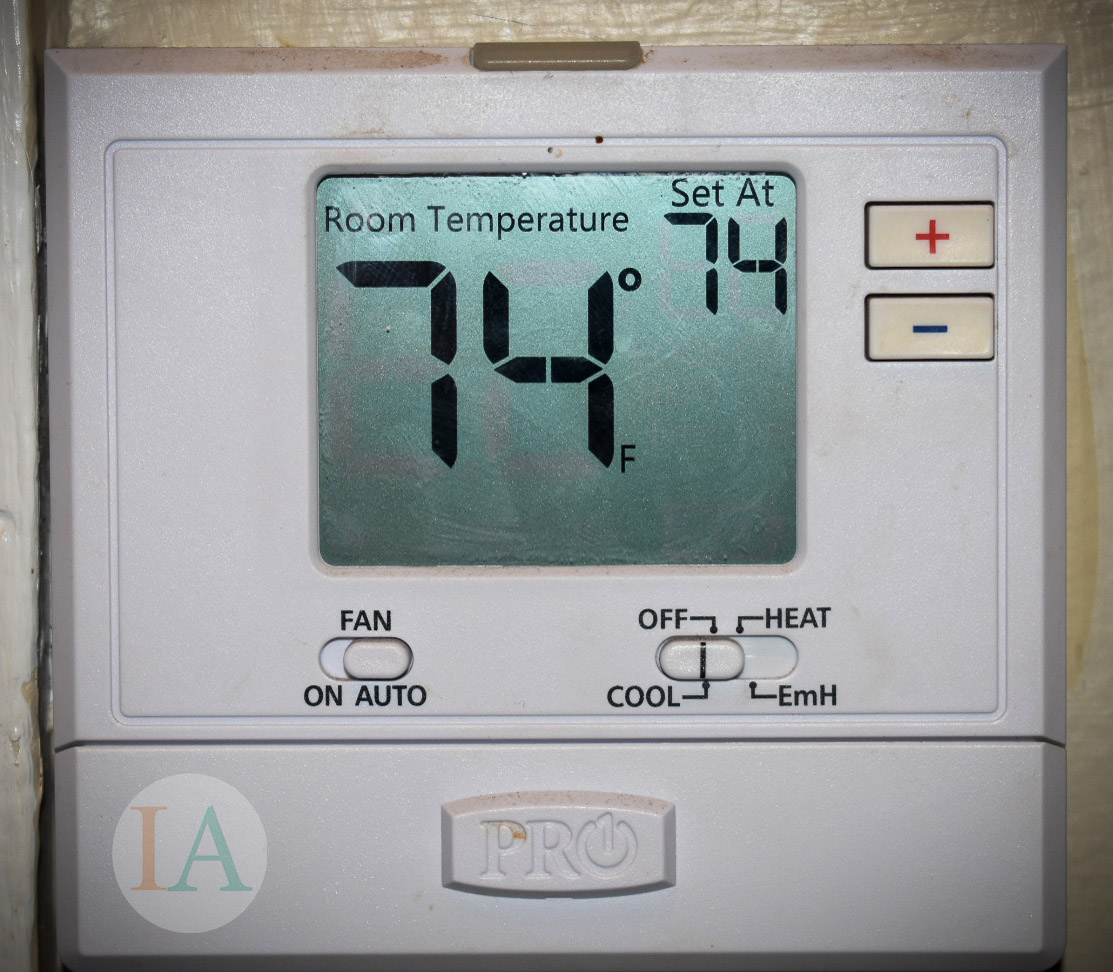 Thermostat for central heating and air
